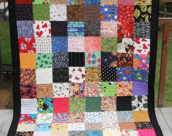 Scrappy I-spy quilt, rag, quilted