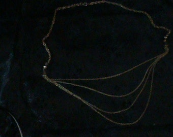 Gold colored 3 layer necklace
