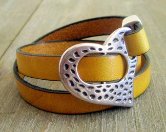 Leather yellow mustard, silver adjustable clasp strap.