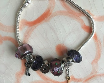 Purple charm bracelet with silver chain