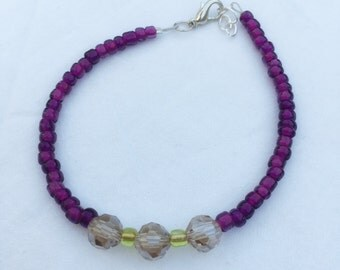 Purple beaded bracelet with lime and lavender accent beads