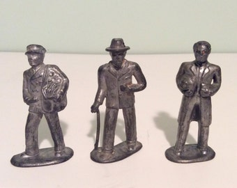 Vintage Barclay lead figurines, Barclay Railroad passengers figures, seven three inches tall lead collectible figures.
