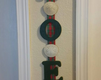 Christmas wall hanger. Noel with sand dollars. Matches Christmas wreath!