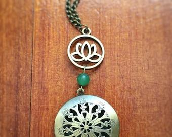Beautiful handmade antique bronze & Jade essential oil diffuser necklace.