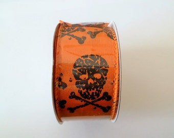 "1 meter wide orange ribbon motif ""skull and bones"""