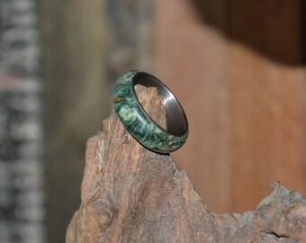 Titanium ring with burl