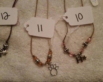 Charm necklaces on hemp