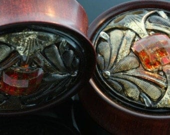 1 3/4 or 44mm Bloodwood with Glass inlay.   Only pair ever made.