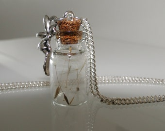 Small glass vials with dandelions and a little fairy