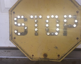 Vintage Yellow Stop Sign with Marbles