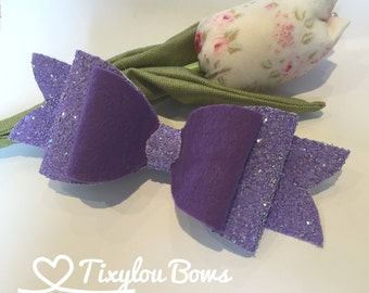 Handmade glitter and felt bow in purple and lilac