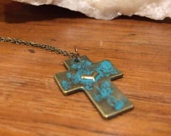 Brass cross pendant on brass chain.