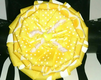 Yellow and white polka dot flower hair bow