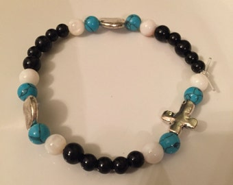 Cute black/white/turquoise bracelet with silver cross--size small
