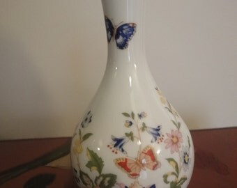 Aynsley small stem vase showing butterfly and floral   height =17cm