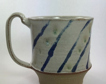 mug with cobalt blue stripes and turquoise dots
