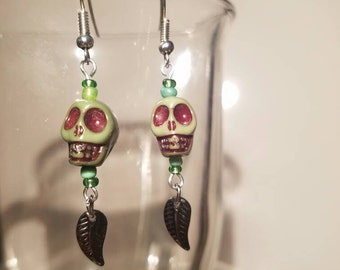 Green Skull Earrings with Leaf Accents