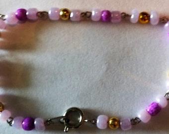 lilac, gold, and magenta bracelet