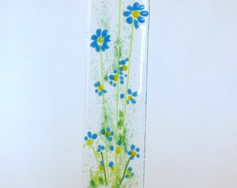 Fused glass blue flower panel on handmade pottery/ceramic base.