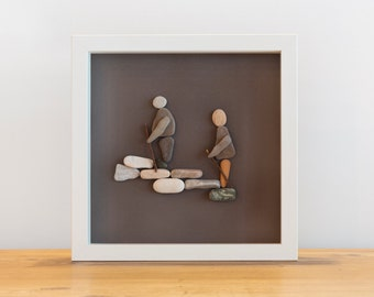 Beach pebble people walking framed art