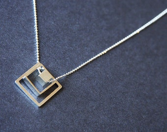 Three square forms: two frames and a cube, all hanging from a diamond cut link Sterling Silver necklace  - Squares Necklace - Geometric toys