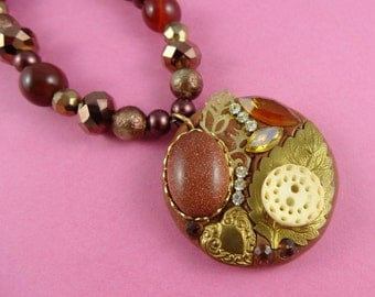 Golden Brown Collage Pendant Necklace - Beaded necklace with a handmade polymer clay & assemblage pendant, including a goldstone cabochon