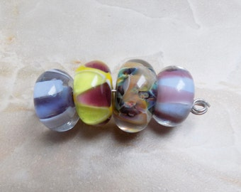 Four orphan Boro glass beads
