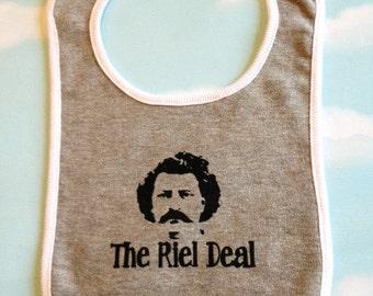 Winnipeg childrens bib of The Riel Deal. Louis Riel silk screened baby bib.