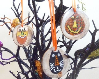 3 Hand Painted Primitive Halloween Branch Slice Ornaments. Pumpkin or Jack-o-lantern, Candy Corn, Black Cat.   Painted by Me.