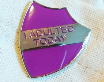 I Adulted Today enamel shield merit badge