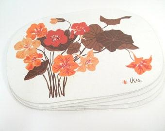 Vintage Vera Neumann ladybug vinyl placemats, orange and brown botanical flowers, set of 6