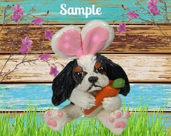 Tri Colored Cavalier King Charles Spaniel Easter Bunny dog with Carrot OOAK Clay art sculpture by Sallys Bits of Clay