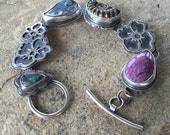 SALE>>>  25% off marked price.... Boulder opal, purpurite, and pyrite ammonite, sterling silver handmade bracelet.