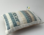 Pin cushion in white and soft blues - hand stitched embroidery