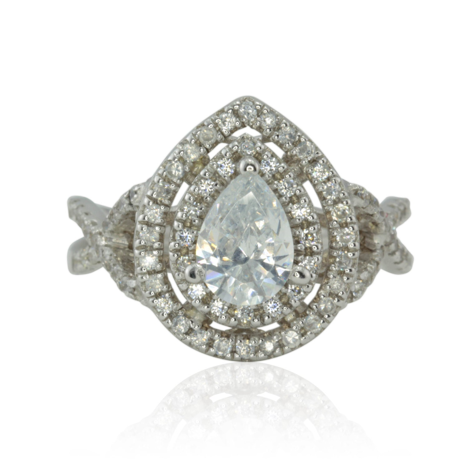 cubic zirconia engagement ring with pear shaped cz halo