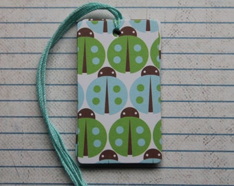26 blue green ladybug patterned paper over chipboard gift tags