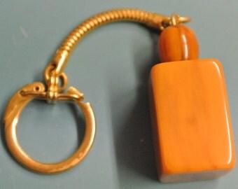 Keyring/keychainholder with genuine tested vintage 1940s swirled goldbrown bakelite plastic pendant