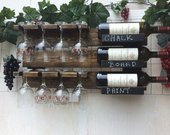 DISTRESSED Recliamed, repurposed wood. Wooden wall mounted wine rack that holds 3 bottles 8 glasses. Comes with chalkboard paint.