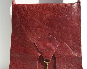 SALE Raw edge leather bag with brass key detail - antique red