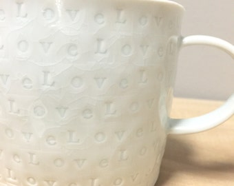 love - porcelain cup with translucent bottom