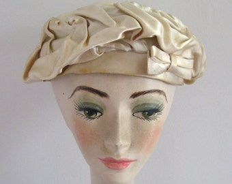 beret . cream satin beret . beret with flaws . peck & peck . study in hat making . 60s hat