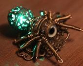 Glowing Steampunk Spider Brooch made with antique clock parts and taxidermy glass eye