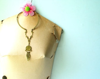 Hippie vintage 60s , brass finished, hand made bib necklace with a peruvian coin and tassel.
