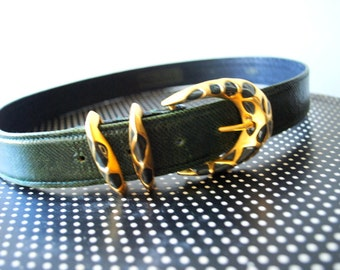 classy vintage 80s forest green genuine leather belt with animal print brass buckle. Made by Carlisle.Size M.