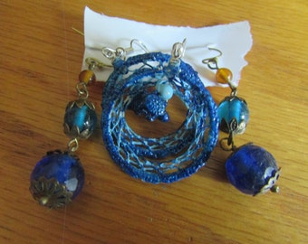 set of two blue themed dangle earrings
