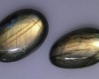 2 Labradorite ovals, very good or better greenish gold flash, 99.17 carats total          043-10-681