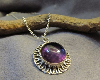 Amethyst and sterling silver round pendant