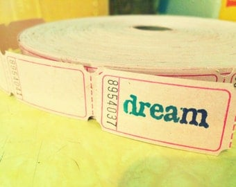 "Ten hand stamped ""dream"" tickets in pale pink"