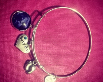Silver plated bangle with ultrasound picture and baby themed charms.