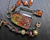 Fatima. Dark orange necklace, mixed media assemblage art jewelry.